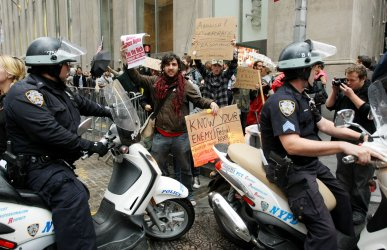 Demonstrators march on Wall Street in New York