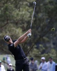 Henrik Stenson of Sweden hits an iron at the Masters