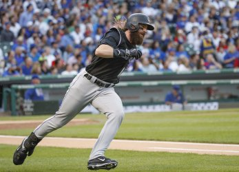 Rockies Charlie Blackmon hits a double against the Cubs in Chicago