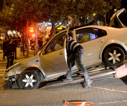 Car plows into Jerusalem crowd: one child killed, eight injured