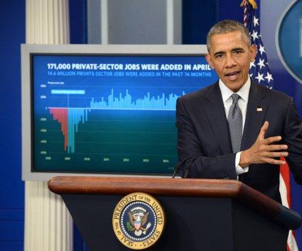 Obama touts job creation despite weak economic report