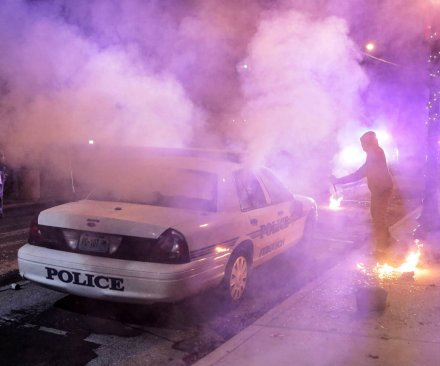 Ferguson: Protesters torch police car as tension and unrest seen for 2nd night