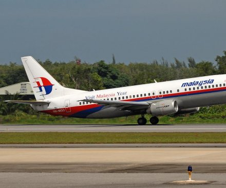 Malaysia Airlines MH17 victims' bodies arrive in Kuala Lumpur
