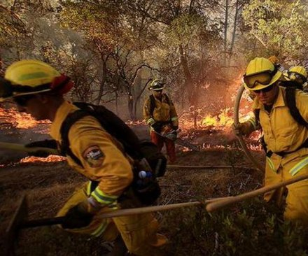 California governor declares emergency due to wildfires, firefighter killed