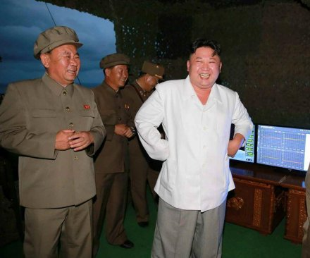 North Korea extolls 'victorious' missile launch; Kim Jong Un plans new subs