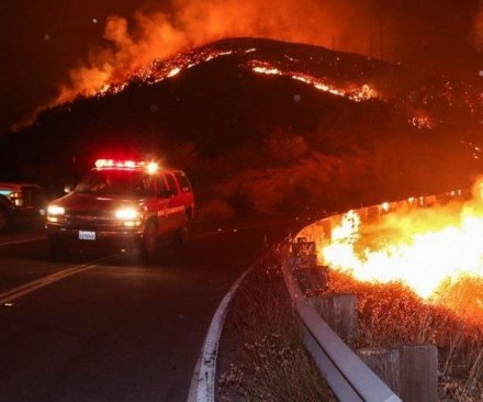One dead, homes torched, thousands evacuated by Southern California wildfire