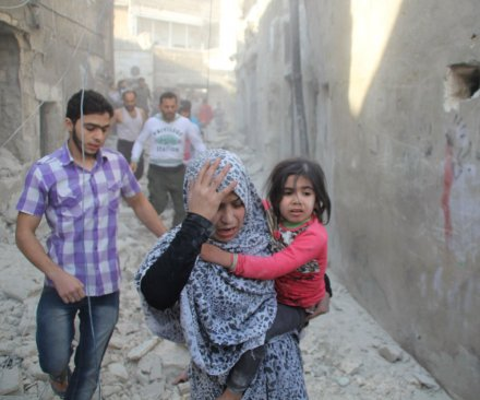 Barrel bombs dropped on Aleppo funeral wake for children