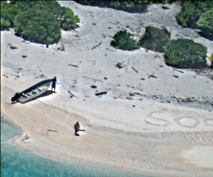 Pair rescued from Pacific island after writing 'SOS' in the sand