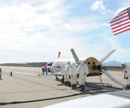 Unmanned space plane lands after 22-month mission