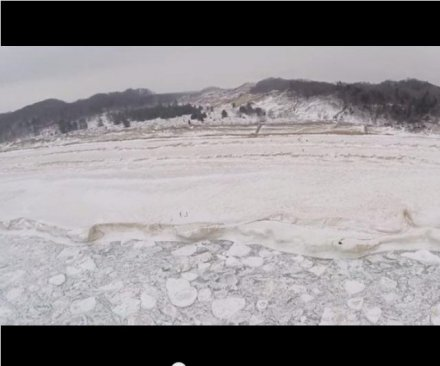 Drone video tours frozen shore of Lake Michigan