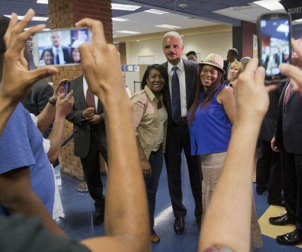 Holder: 'Change is coming' to Ferguson after shooting
