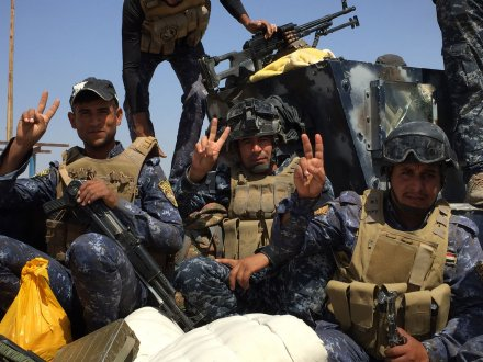 Iraqi forces celebrate victory