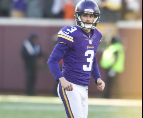 Seattle Seahawks kicker Blair Walsh gestures toward ex-Minnesota Vikings teammates