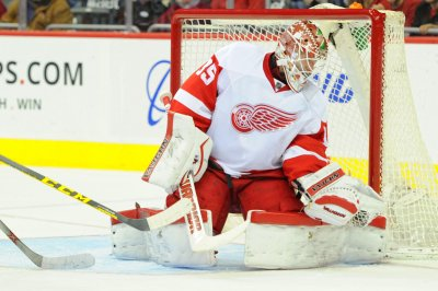 Red Wings goalie Jimmy Howard steals stick with skate