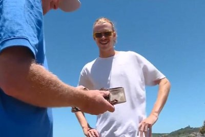 Wallet lost on Australian beach returned to owner 25 years later
