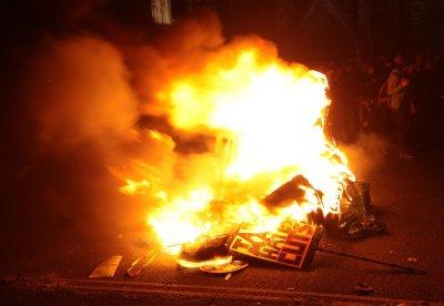 Cameron condemns student violence