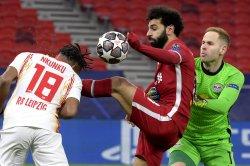 Champions League soccer: Salah, Mane lead Liverpool over Leipzig