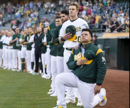 Oakland Athletics' Bruce Maxwell becomes first MLB player to kneel during national anthem