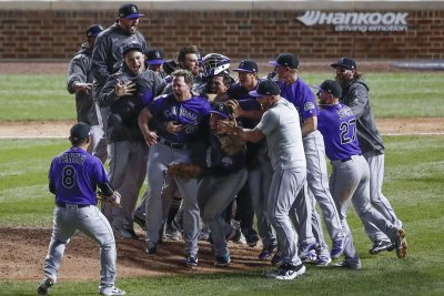Rockies beat Cubs in 13th to advance to NLDS