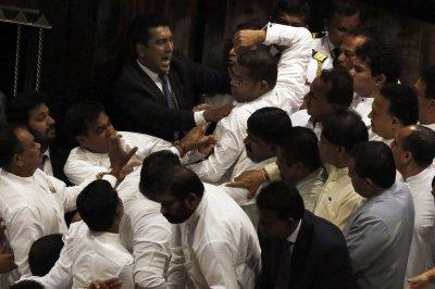 1 legislator hospitalized after Sri Lanka parliament brawl
