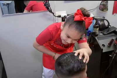 Seven-year-old barber draws attention at Houston shop