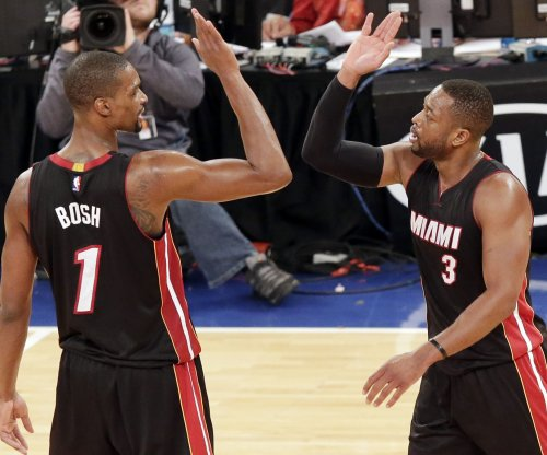 Bosh, Deng power Miami Heat over Sacramento Kings