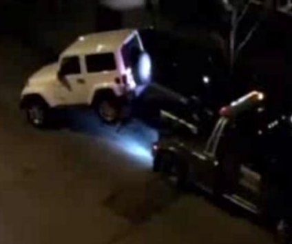 Jeep's tow truck escape caught on camera in Chicago
