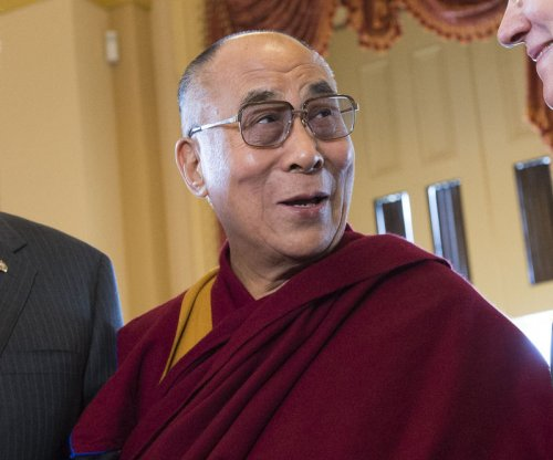 Dalai Lama hits Glastonbury stage with Patti Smith