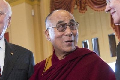 Dalai Lama hits Glastonbury stage with Patti Smith