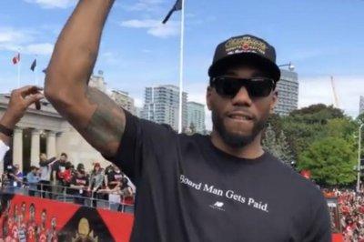 Kawhi Leonard wears 'Board Man Gets Paid' shirt at Raptors parade