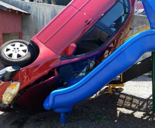 Car 'flew off the road,' landed on California playground slide