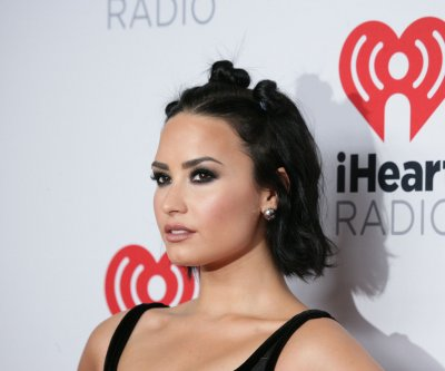 Demi Lovato debuts music video featuring Michelle Rodriguez