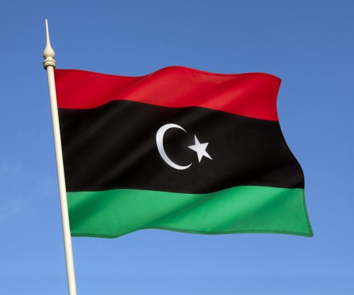 Rival governments in Libya reach power-sharing agreement