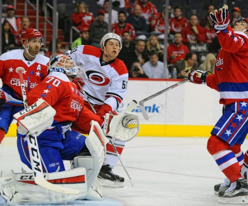 Washington Capitals clinch playoff spot with OT win over Carolina Hurricanes