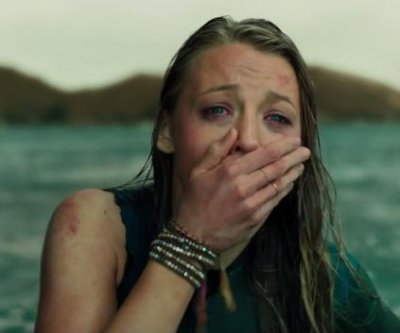 Blake Lively fights off a deadly shark in the second trailer for 'The Shallows'