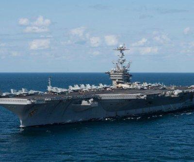 Aircraft carrier USS Truman docks for maintenance after seven months at sea