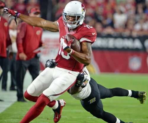 Confident Cardinals accept underdog role in Seattle