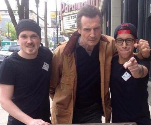 'Liam Neeson eats here free' sign draws actor to sandwich shop