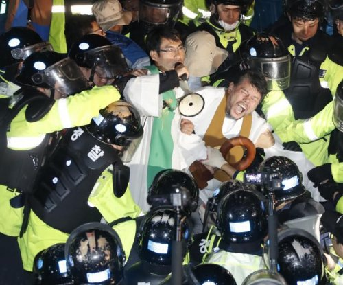 South Korea THAAD protester dies after setting himself on fire