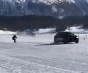 Snowboarder towed by Maserati breaks speed record