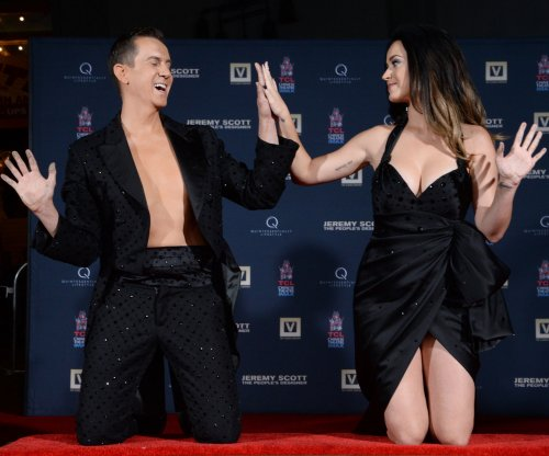 Katy Perry, Jeremy Scott take part in handprint ceremony