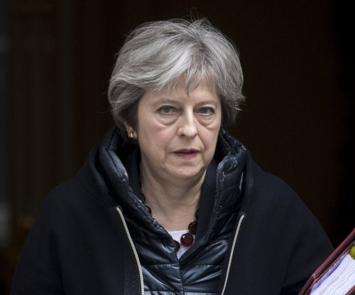 Theresa May expels 23 Russian diplomats over poison attack