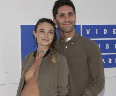Nev Schulman's pregnant fiancee Laura Perlongo wears open blazer, no shirt to VMAs