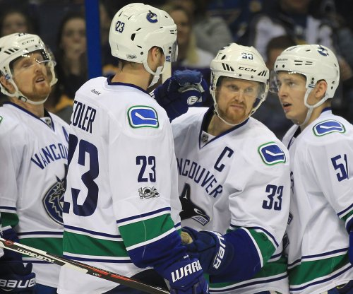 Big second period powers Vancouver Canucks past Minnesota Wild