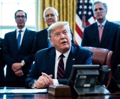 President Trump signs $2T coronavirus relief bill