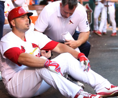 St. Louis Cardinals' Matt Holliday exits with leg injury