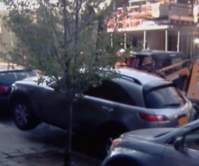 Developer apologizes for using forklift to move legally parked SUV
