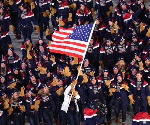 Opening ceremony: USA's Davis skips event after flag bearer comments