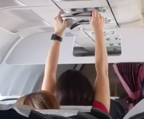 Plane passenger uses overhead vent to dry underwear
