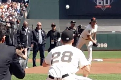 Former Giants pitcher Brian Wilson wears full uniform for ceremonial first pitch